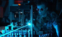 Image of military person performing laser experiment